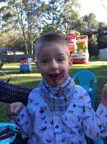 Archie enjoying cake at his birthday party